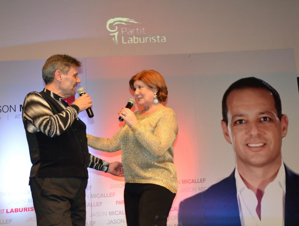 Another prominent guest at the Vitals party yesterday: Mary Spiteri, seen her singing with her former Gensna co-star Renato in front of a backdrop bearing a large photograph of Jason Micallef's face, to promote him as an election candidate in 2013. He failed to be elected.