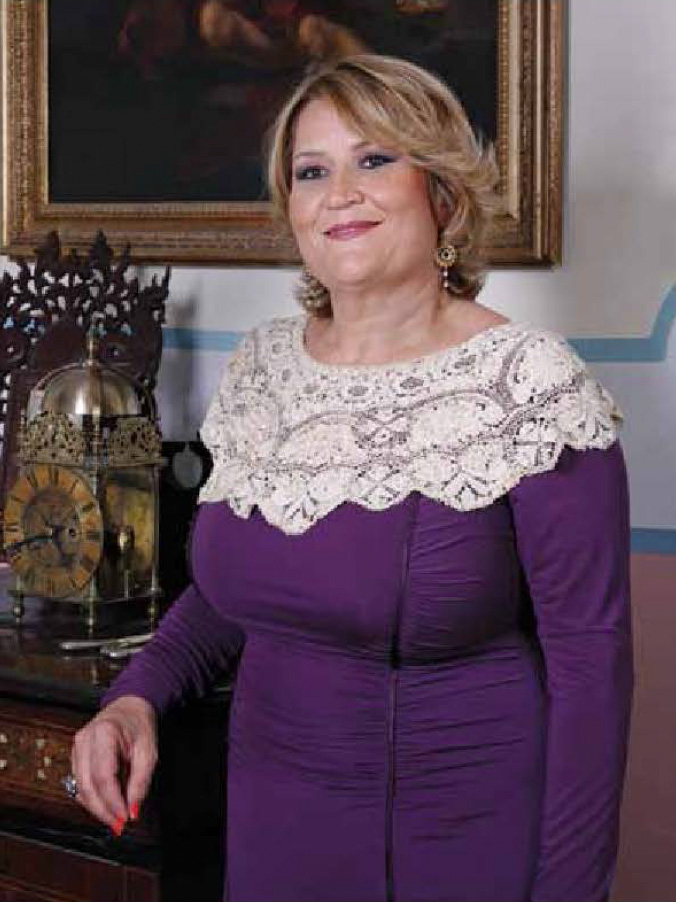 Laburista in Lace: the Prime Minister's special friend, Phyllis Muscat, was a prominent guest at the big Christmas bash thrown by Vitals 'Global Healthcare' at a St Julian's hotel last night.
