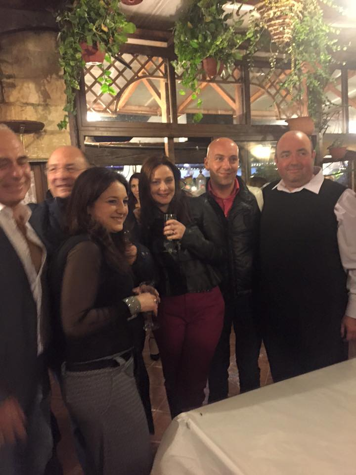 Neville Gafa celebrating last December with Minister Michael Farrugia and Farrugia's girlfriend, Amanda Mifsud, who has been installed as a senior director at Identity Malta.