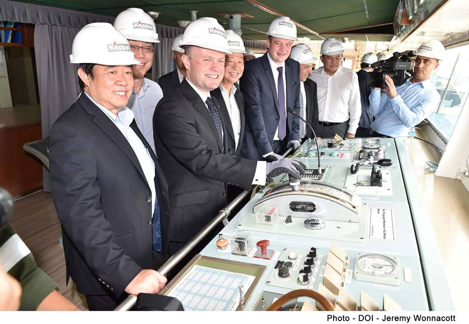 Joseph Muscat, Keith Schembri and Konrad Mizzi in Bumi Armada hard hats in Singapore yesterday. The client for the Bumi Armada tanker is Electrogas Malta Ltd and not the government, but the Maltese owners of Electrogas were nowhere to be seen.